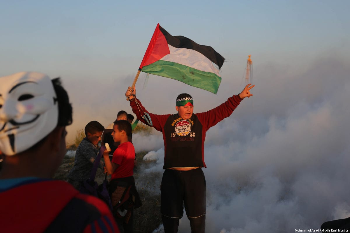 "Palestinian protestor seen during a weekly ""Great March of Return"" demonstration near the Israel-Gaza border, on March 22, 2019 [Mohammad Asad / Middle East Monitor]"