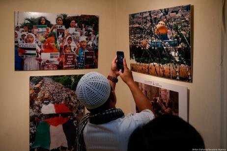 A visitor takes a photo of exhibition about history of Palestine during the 54th Anniversary of the Palestinian Revolution in Jakarta, Indonesia on 27 February 2019 [Anton Raharjo/Anadolu Agency]
