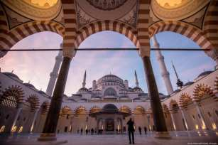 ISTANBUL, TURKEY - MARCH 07: A man takes a photograph in the courtyard of Camlica mosque after taking part in the first official public prayer marking the opening of Camlica Mosque on March 7, 2019 in Istanbul, Turkey. Camlica Mosque is now Turkey's largest mosque capable of accommodating more than 40,000 people. The mosque sits on Camlica hill with sweeping views over Istanbul. Construction on the mega project, which was championed by Turkey's president Recep Tayyip Erdogan, started in 2013 at a cost of approximately 150 million Turkish Lira. The mosque was designed by two female architects and includes a museum, art gallery and library. (Photo by Chris McGrath/Getty Images)