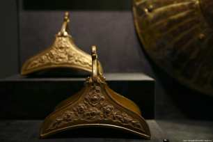 "Tombac stirrups produced for Ottoman army are displayed at Tombac: ""Elegance with a Touch of Gold"" exhibition in Istanbul on 5 March 2019 [Veli Gürgah - Anadolu Agency]"