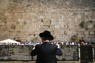 A Jewish man seen during the Sukkot Holiday (Tabernacles Feast) celebrated by Jewish people in Old City of eastern Jerusalem, at the Western Wall, Jerusalem on September 25, 2018 [Mostafa Alkharouf / Anadolu Agency]