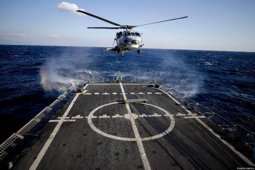 A helicopter lands on a frigate deck during 'Blue Homeland 2019' naval drill in Antalya, Turkey on February 27, 2019. [Mustafa Çiftçi - Anadolu Agency]