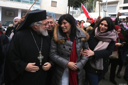 Member of Palestinian Popular Front for the Liberation of Palestine (PFLP) and former lawmaker at the Palestinian Legislative Council (PLC) Khalida Jarrar (C) is seen as she is welcomed by her supporters and relatives after she was released from detention lasted 20 months, in front of her house in Nablus, West Bank on February 28, 2019 [Issam Rimawi - Anadolu Agency]