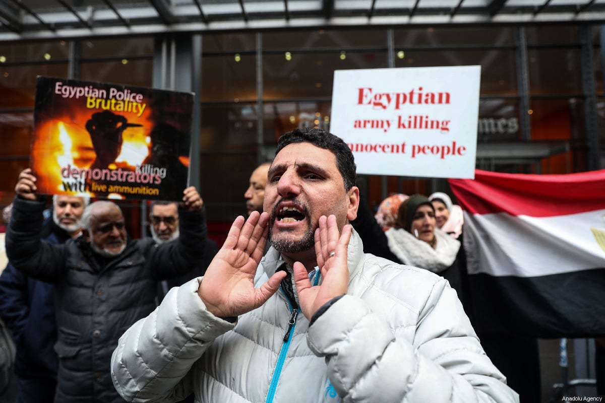 A group of people gather to stage a protest against executions in Egypt, in front of the New York Times Building, in New York, United States, on 02 March 2019 [Atılgan Özdil/Anadolu Agency]