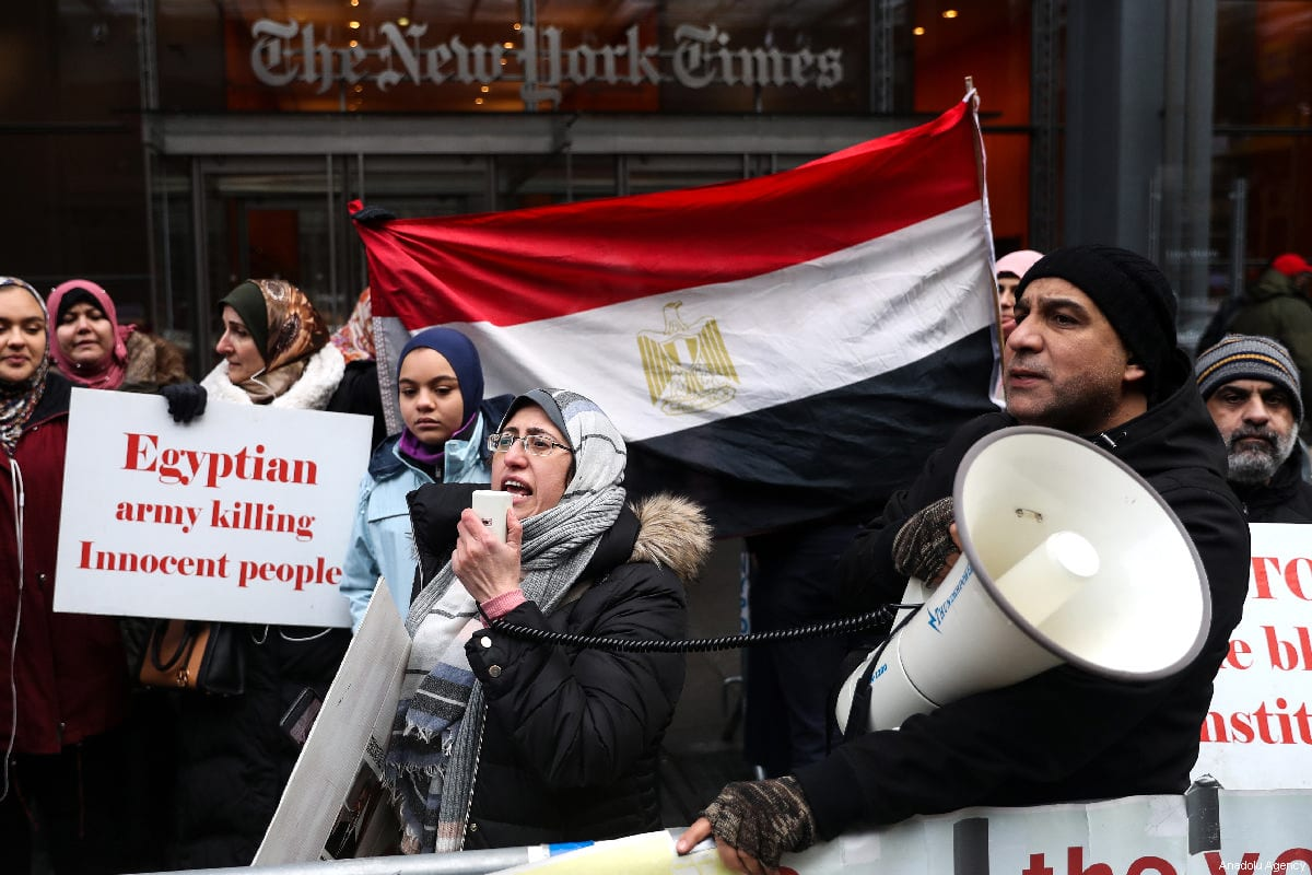 A group of people gather to stage a protest against executions in Egypt, in front of the New York Times Building, in New York, United States, on March 02, 2019 [Atılgan Özdil/Anadolu Agency]
