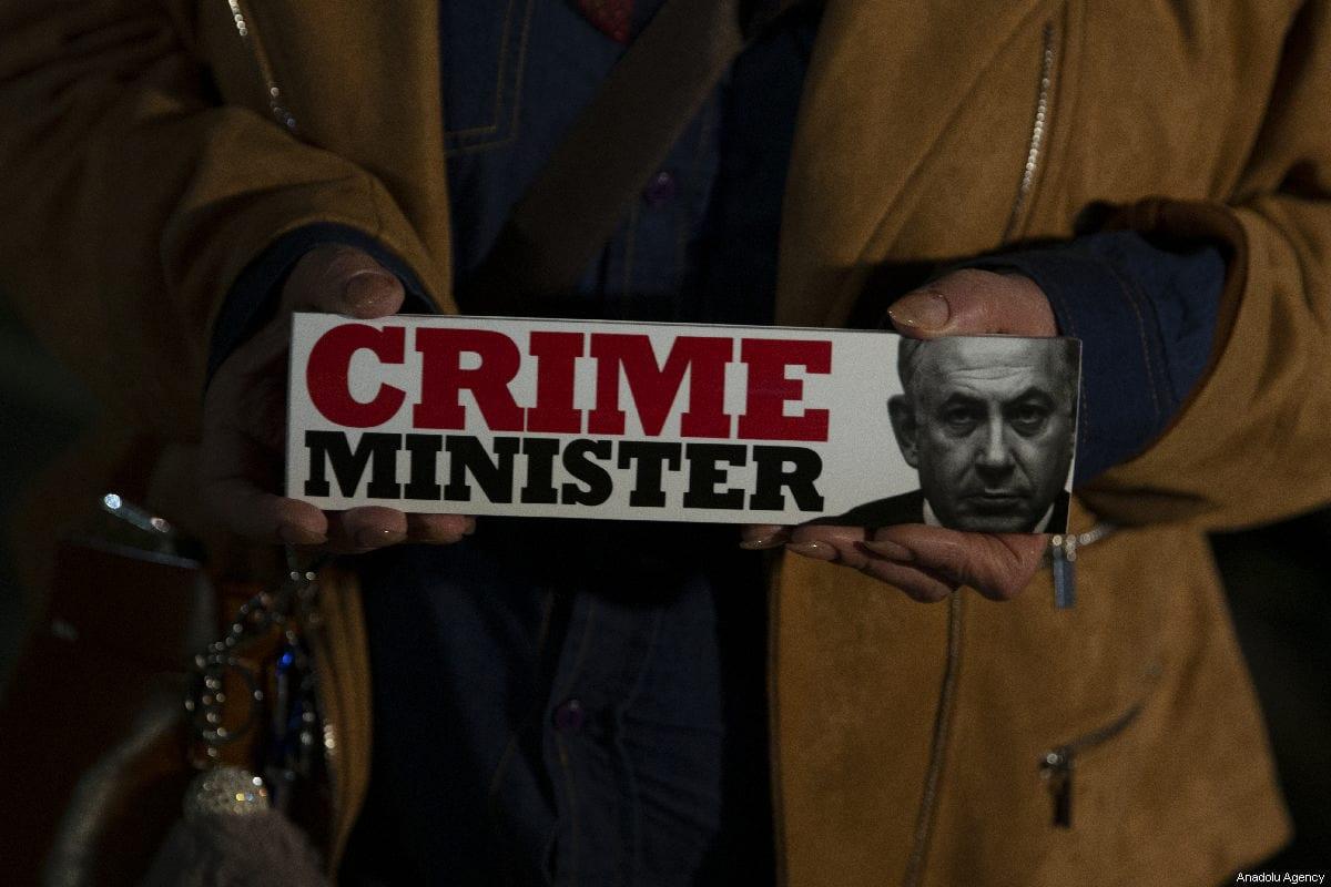 Demonstrators hold placards and shout slogans during the protest against Israeli Prime Minister Benjamin Netanyahu in Tel Aviv on 3 March 2019 [Faiz Abu Rmeleh / Anadolu Agency]