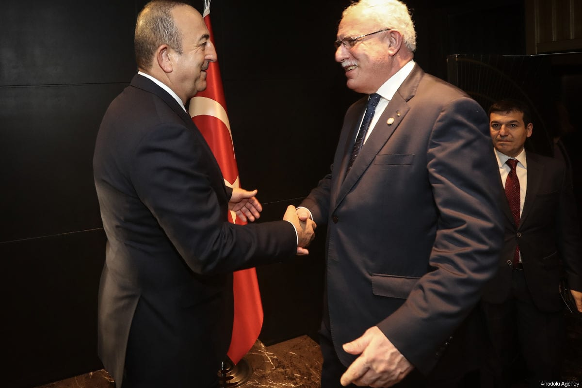 Turkish Foreign Minister Mevlut Cavusoglu (L) and Palestinian Foreign Minister Riyad al-Maliki (R) shake hands prior to their bilateral meeting within the consultation meeting with ambassadors of Palestine to European countries in Istanbul, Turkey on March 03, 2019 [Cem Özdel / Anadolu Agency]