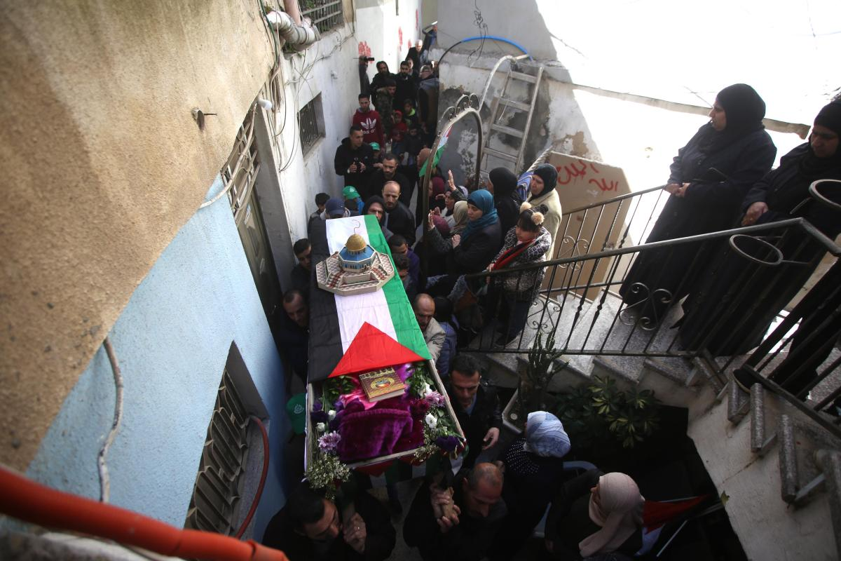 Palestinians carry the coffin of Palestinian girl Samah Mubarak, who was killed by Israeli forces claimed that she attempted to stab a security guard at the checkpoint before she was fatally shot, during her funeral ceremony in Ramallah, West Bank on 9 March, 2019 [Issam Rimawi/Anadolu Agency]