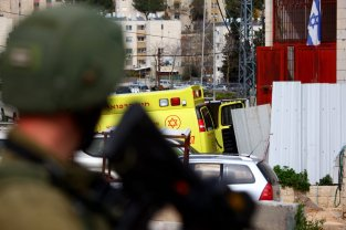 Israeli forces take security measures after a Palestinian man was shot and killed by Israeli forces following an alleged knife attack in the occupied West Bank on March 12, 2019 in Hebron, West Bank. ( Mamoun Wazwaz - Anadolu Agency )