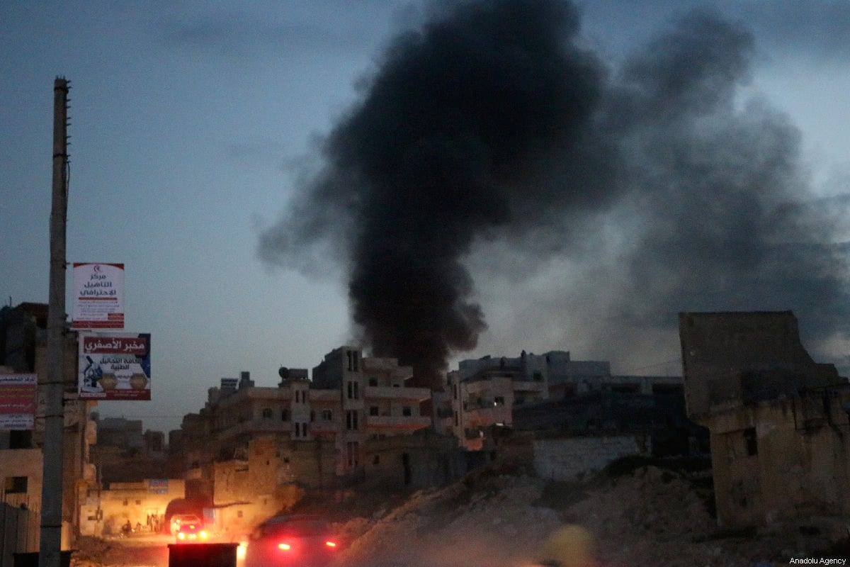 Smoke rises after an airstrike hits the city center in Syria's northwestern Idlib province on March 13, 2019 [Ahmet Rehhal / Anadolu Agency]