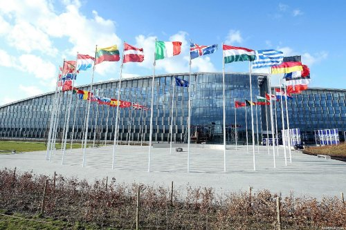 Flags of members of North Atlantic Treaty Organisation (NATO) wave outside of the NATO Headquarters in Brussels, Belgium on 14 March 2019 [Dursun Aydemir/Anadolu Agenc