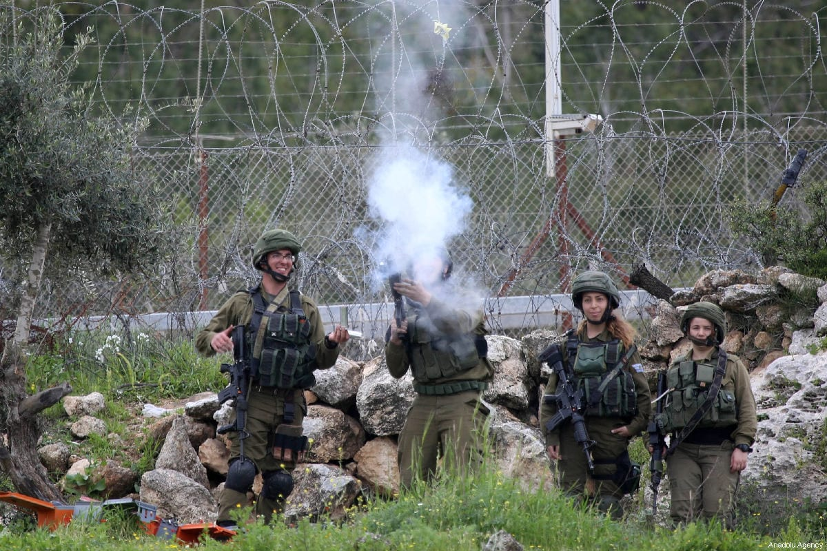 Israeli forces fire at Palestinians with tear gas during a protest in the West Bank on 15 March 2019 [Issam Rimawi/Anadolu Agency]