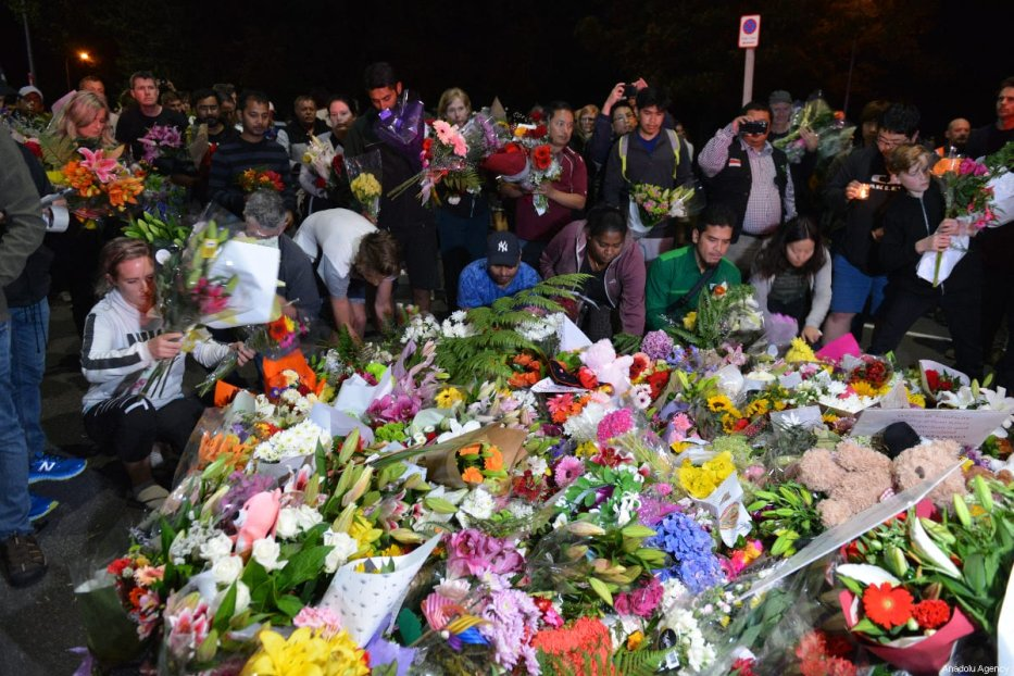 People lay flowers and notes to pay tribute at streets close to the Masjid Al Noor Mosque and Linwood Mosque, shooting area, in Christchurch, New Zealand on March 16, 2019. ( Recep Şakar - Anadolu Agency )