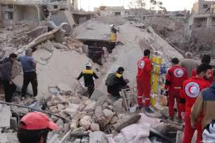 Civil defence members conduct a search and rescue operation after the Syrian regime carried out air strikes in Syria on 22 March 2019 [Hasan Muhtar/Anadolu Agency]