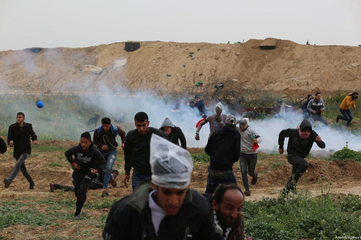 "Israeli forces intervene Palestinians with tear gas during a protest within the ""Great March of Return"" and ""Palestinian Land Day"" demonstrations at Israel-Gaza border located near Al Bureij Refugee Camp in Gaza City, Gaza on 03 March 2019. [Hassan Jedi - Anadolu Agency]"