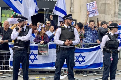 "A small group holding Israeli flags were holding a counter protest as Hundreds of protesters gather in front of the Israeli Embassy in central London in solidarity with Palestinian people who are holding large ""Great March of Return"" and ""Palestinian Land Day"" rallies across Gaza border, in London, United Kingdom on March 30, 2019 [Hasan Esen / Anadolu Agency]"