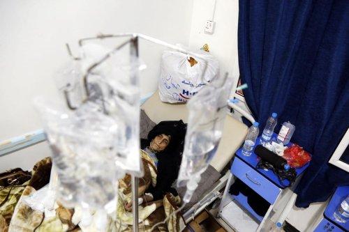 Yemeni women receive treatment for cholera in Sanaa, Yemen on 10 March 2019 [Mohammed Hamoud/Anadolu Agency]