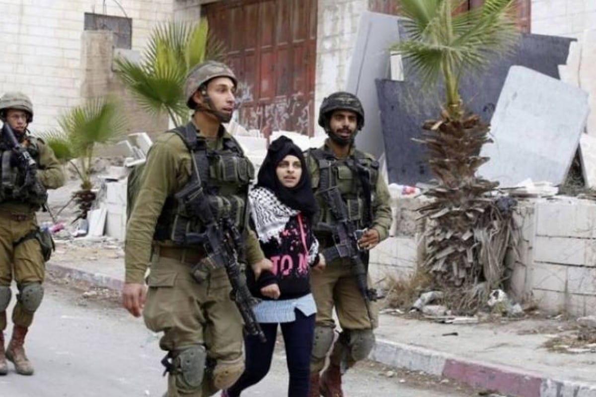 Israeli forces arrest a Palestinian woman at a military checkpoint in Hebron after she posted a comment on Facebook on Al-Aqsa Mosque [Shehab News]