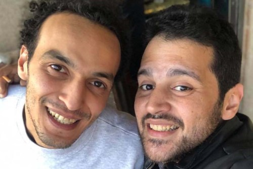 Egyptian photojournalist Shawkan (left) smiles on his release from prison [Facebook]
