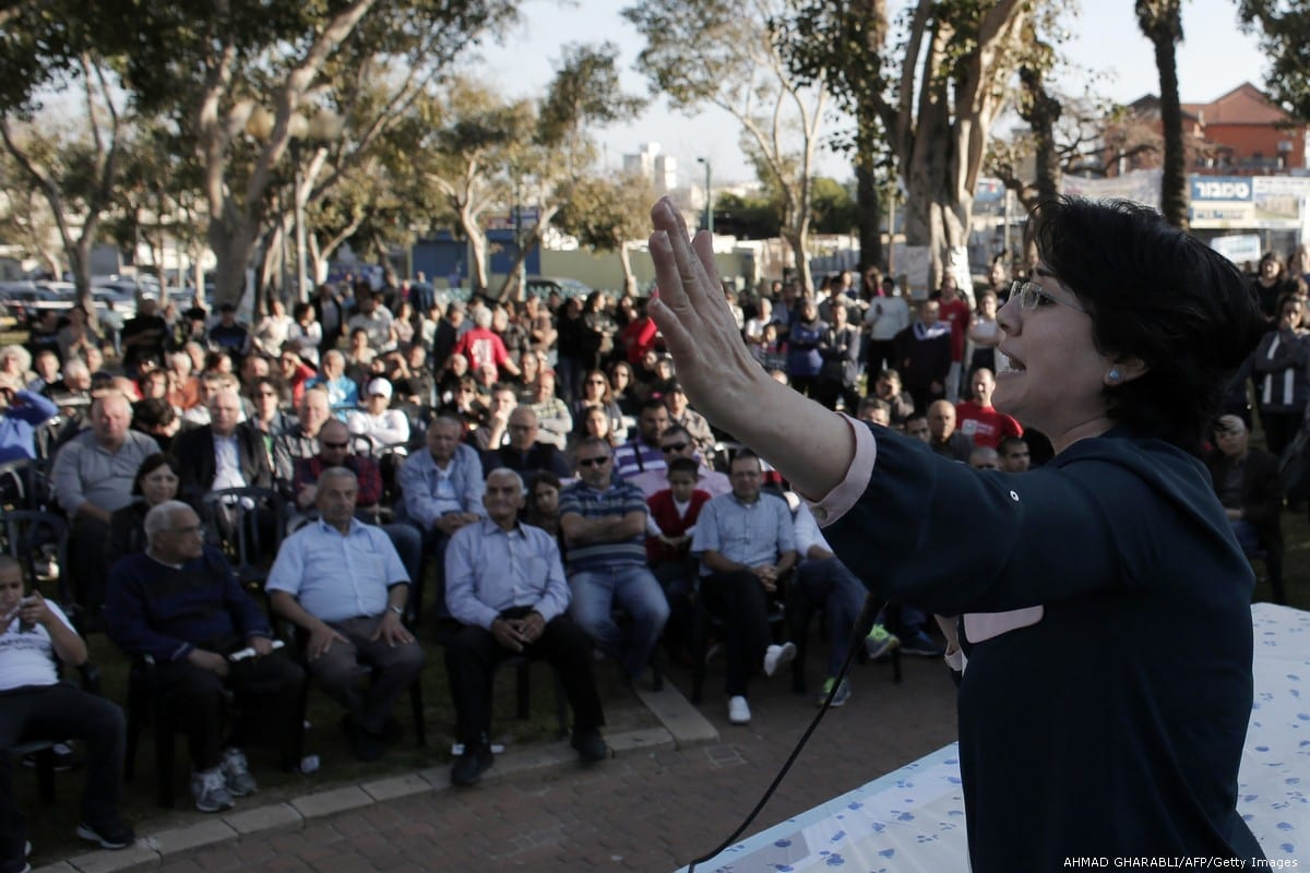 Arab-Israeli Member of Parliament with the Balad party, Haneen Zuabi speaks during a campaign meeting ahead of the Israeli general election on 14 March 2015 in Tel Aviv [AHMAD GHARABLI/AFP/Getty Images]