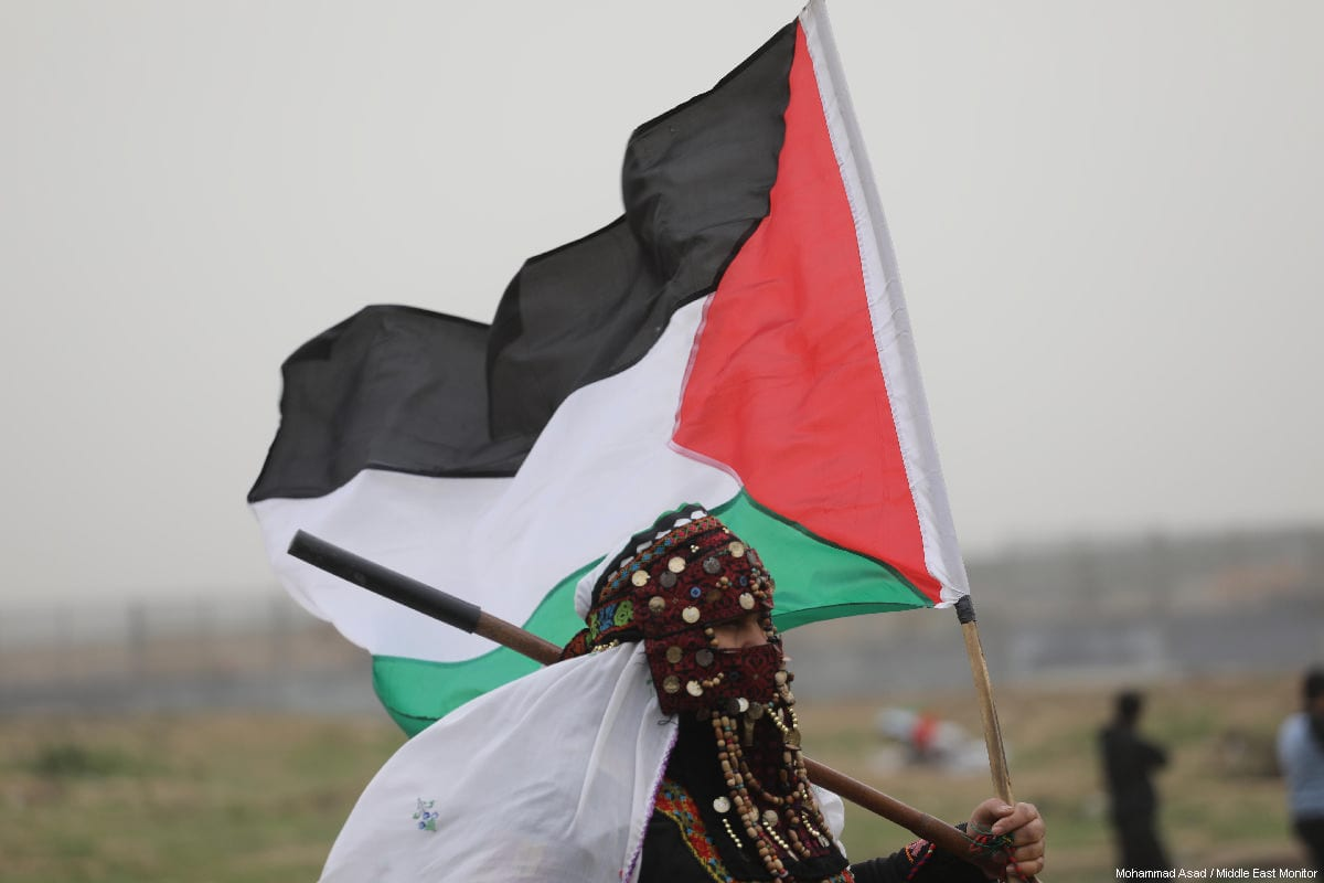 "Palestinians seen at the anniversary march of the ""Great March of Return"" and ""Palestinian Land Day"" protests at Israel-Gaza border on March 30, 2019 [Mohammad Asad / Middle East Monitor]"