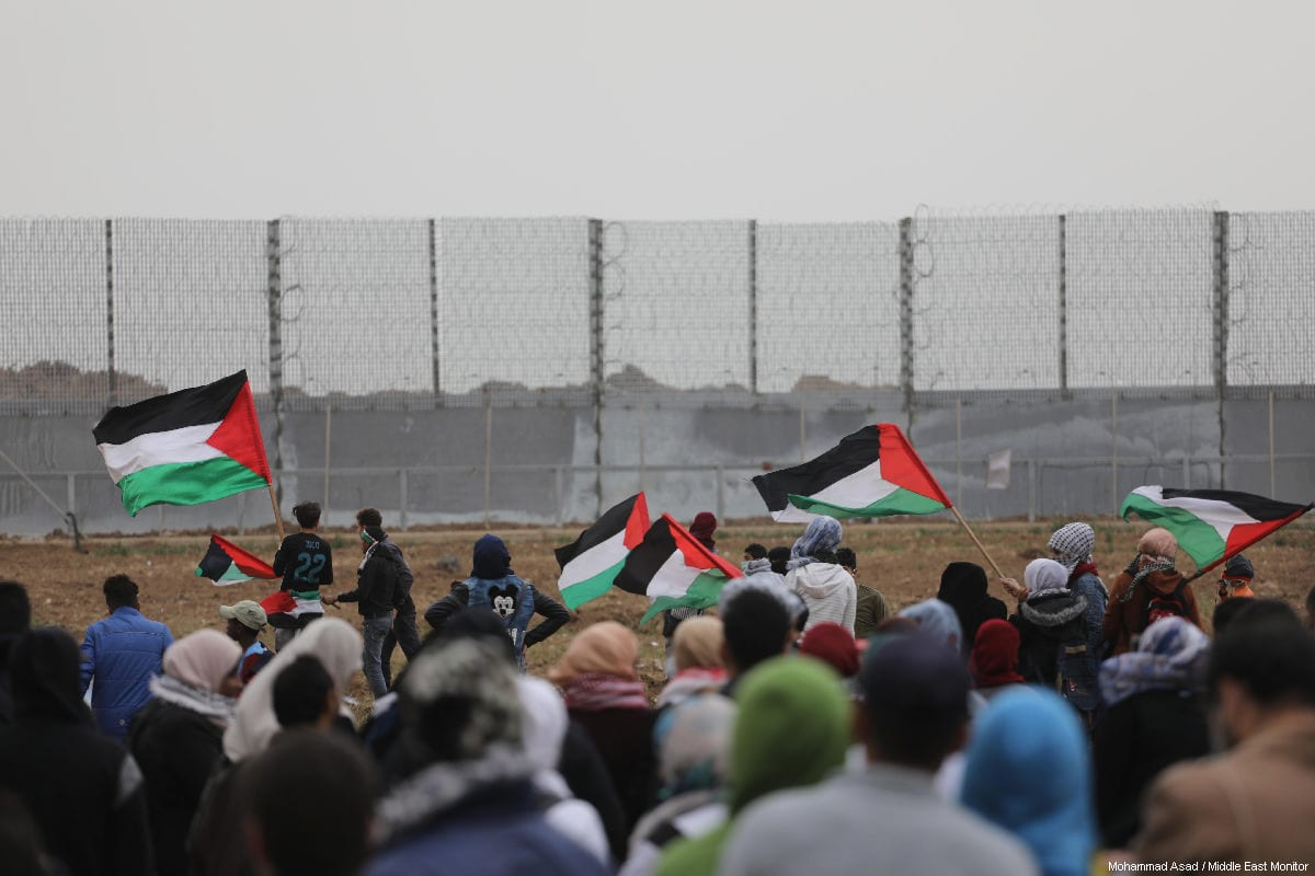 """Palestinians seen at the anniversary march of the """"Great March of Return"""" and """"Palestinian Land Day"""" protests at Israel-Gaza border on March 30, 2019 [Mohammad Asad / Middle East Monitor]"""