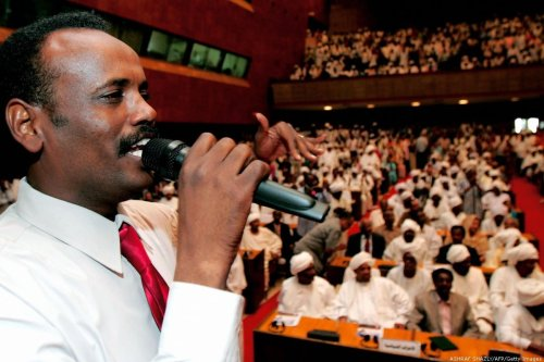 A Sudanese communist party convention organiser speaks to participants and delegates attending the fifth general convention of the party, the first such meeting for over 40 years, in Khartoum on 24 January 2009. [ASHRAF SHAZLY/AFP/Getty Images]
