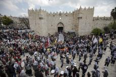 People gather at Damascus Gate within an event to mark the Lailat al-Isra and Miraj in Jerusalem on April 03, 2019. ( Faiz Abu Rmeleh - Anadolu Agency )
