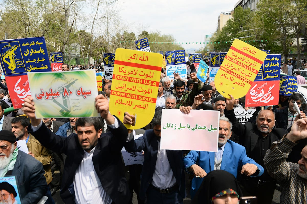 "Iranians hold anti-US placards as they take part in a protest against the Trump administration's designation of Iran's Islamic Revolutionary Guards Corps (IRGC) as a ""terrorist organization"" in Tehran, Iran on 12 April 2019. [Fatemeh Bahrami - Anadolu Agency]"
