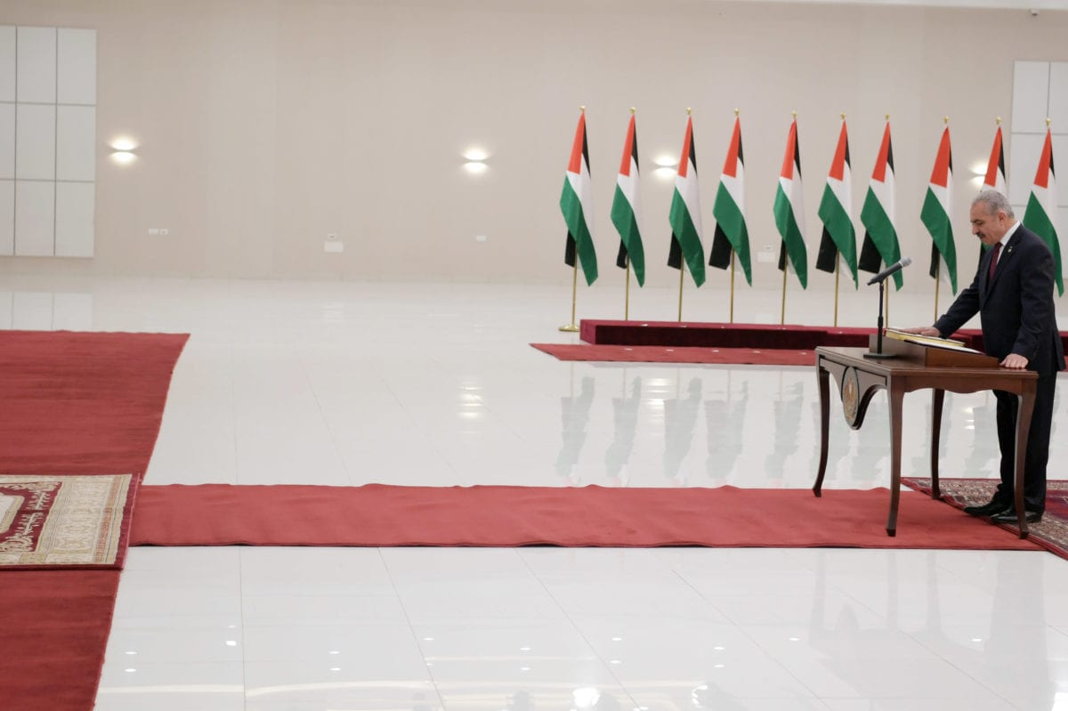 PA Prime Minister Mohammad Ishteya swears in at the Presidential Office in Ramallah, West Bank on April 13, 2019. [Thaer Ghanaim/ Palestinian Presidency / Handout - Anadolu Agency]
