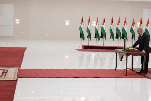 PA Prime Minister Mohammad Ishteya swears in at the Presidential Office in Ramallah, West Bank on April 13, 2019. [Thaer Ghanaim/ Palestinian Presidency / Handout - Anadolu Agency]