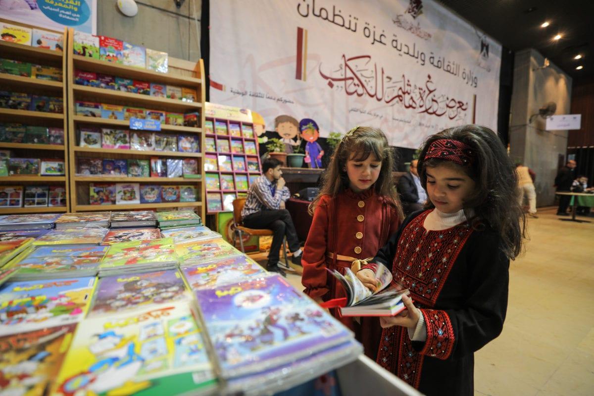 "Palestinian students visit the Rashad Al Shawwa Cultural Center during ""Gazzetu Hashim"" book fair, which was opened in despite of limited conditions due to Israeli blockade, in Gaza City, Gaza on 14 April 2019 [Mustafa Hassona/Anadolu Agency]"