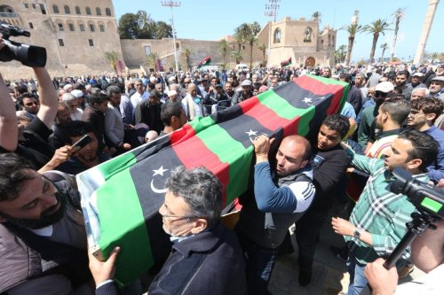People carry a flag-draped coffin of a person who died in a rocket attack by East Libya-based forces led by commander Khalifa Haftar at the Abu Salim neighborhood, during a funeral ceremony at Martyrs' Square in Tripoli, Libya on 17 April 2019. [Hazem Turkia - Anadolu Agency]