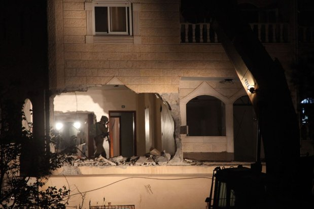 Israeli soldiers inspect the house of Palestinian Arafat Irfaiyye, after it was demolished by a bulldozer in Hebron, West Bank on April 19, 2019 [Mamoun Wazwaz/Anadolu Agency]