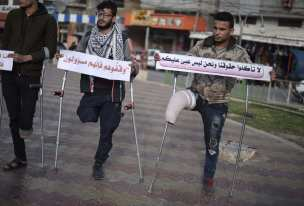"""Handicapped Palestinians, who lost their limbs during the excessive interventions of Israel towards """"Great March of Return"""" demonstrations, stage a demonstration at Unknown Martyrs Square demanding prosthesis legs, medications and better living conditions in Rafah, Gaza on April 21, 2019. ( Abed Zagout - Anadolu Agency )"""