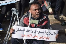 """RAFAH, GAZA - APRIL 21: Handicapped Palestinians, who lost their limbs during the excessive interventions of Israel towards """"Great March of Return"""" demonstrations, stage a demonstration at Unknown Martyrs Square demanding prosthesis legs, medications and better living conditions in Rafah, Gaza on April 21, 2019. ( Abed Zagout - Anadolu Agency )"""