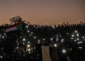 KHARTOUM, SUDAN - APRIL 21: Sudanese demonstrators gather in front of military headquarters during a demonstration after The Sudanese Professionals Association's (SPA) call, demanding a civilian transition government, in Khartoum, Sudan on April 21, 2019. ( Mahmoud Hjaj - Anadolu Agency )