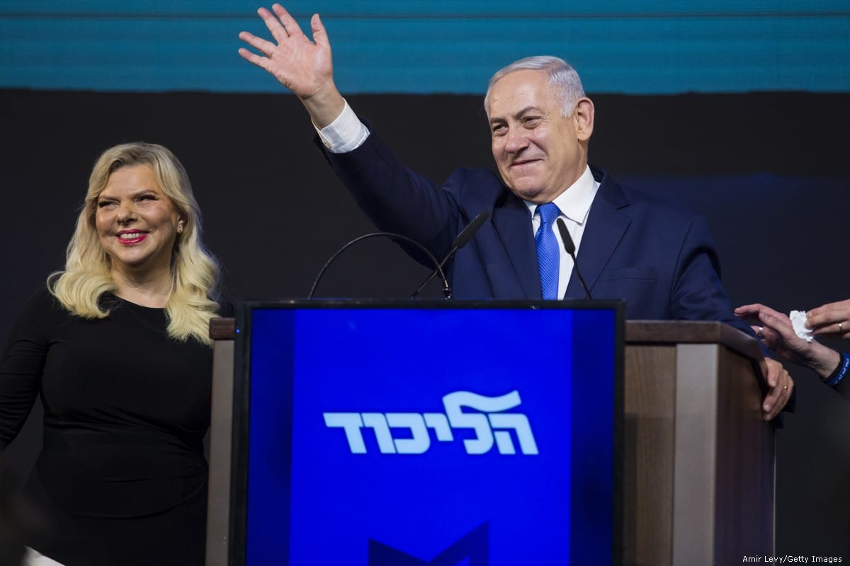 Prime Minster of Israel, Benjamin Netanyahu and his wife, Sara greet supporters on election day on 10 April 2019 in Tel Aviv [Amir Levy/Getty Images]