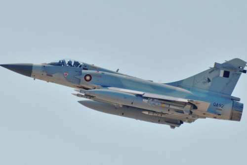 A Qatari Air Force Dassault Mirage 2000-5 fighter jet takes off as part of a Joint Task Force Odyssey Dawn mission against Libya, on March 25, 2011 [US Navy / Paul Farley]