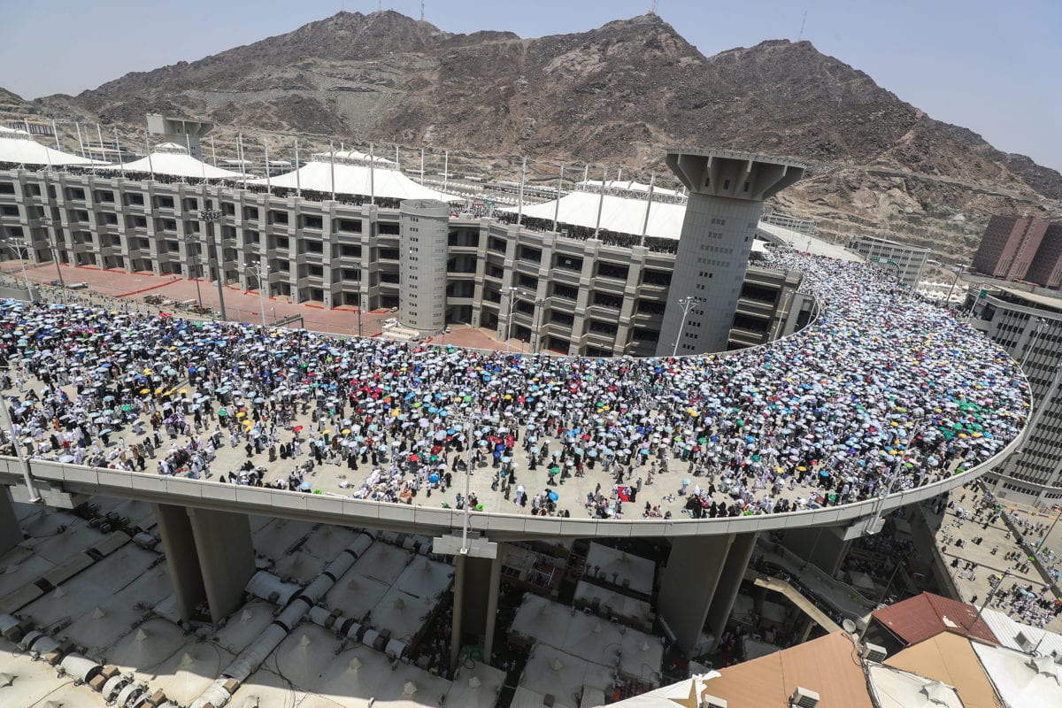 Pilgrims at the Jamarat Bridge in Mina, Mecca during Hajj season [AHMAD AL-RUBAYE/AFP/Getty]