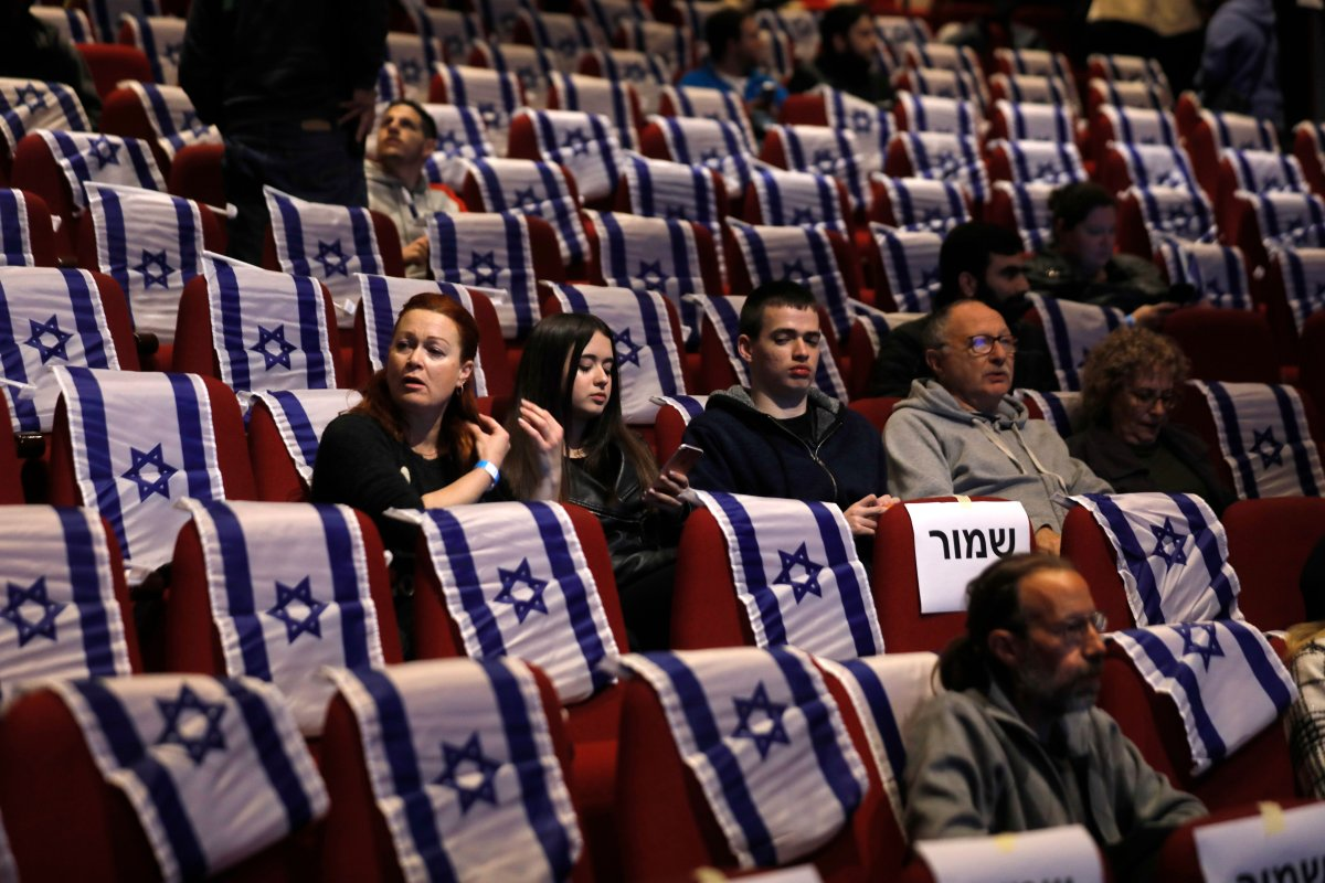 Israelis attend a campaign convention of centrist Blue and White alliance in the southern Israeli city of Beersheva on 11 March, 2019 [MENAHEM KAHANA/AFP/Getty]