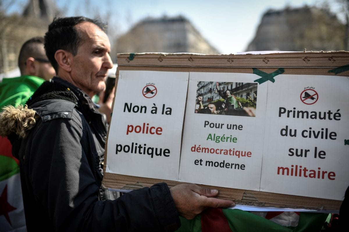 Protesters rally to demand an end to Algerian president Bouteflika's rule on March 31, 2019 at the Place de la Republique in Paris. [STEPHANE DE SAKUTIN / AFP / Getty]