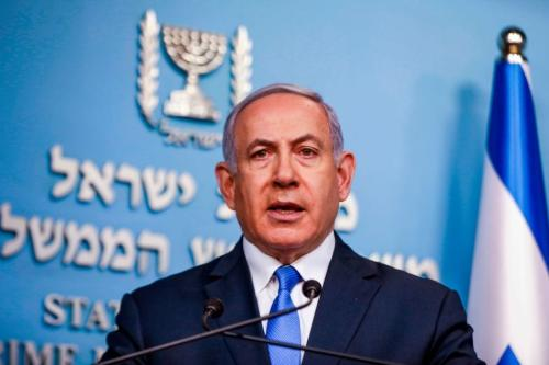 Israeli Prime Minister Benjamin Netanyahu gives an address from his office in Jerusalem on 3 April 2019, announcing that the remains of Sergeant First Class Zachary Baumel, a soldier missing since the 1982 Lebanon war, had been returned to the country. [MENAHEM KAHANA/AFP/Getty Images]
