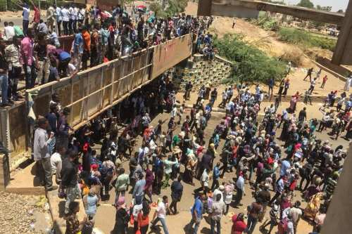 Sudanese protesters gather for a second day outside the military headquarters in the capital Khartoum on April 7, 2019. [AFP / Getty]