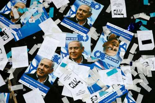 Israeli Likud Party campaign material and posters of Prime Minister Benjamin Netanyahu strown on the floor following election night on April 10, 2019 in Tel Aviv, Israel [Jack GUEZ/AFP/Getty]