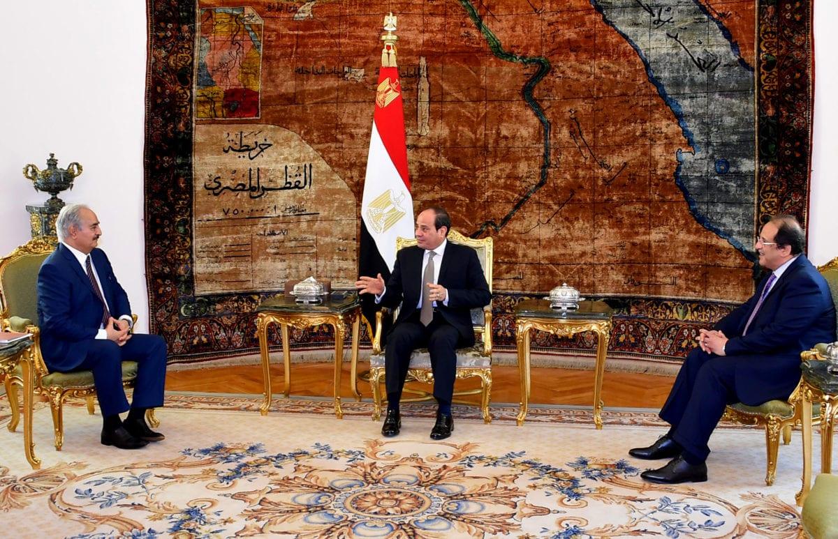 Egyptian President Abdel-Fattah al-Sisi (C) meets East Libya-based military commander Khalifa Haftar (L) at Al Ittihadiyah Palace in Cairo, Egypt on 14 April 2019. [Egyptian Presidency / AFP / Getty]