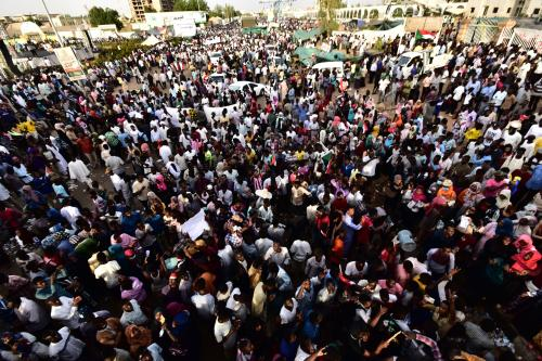 Sudanese demonstrators gather near the military headquarters in the capital Khartoum on 14 April, 2019 [Ahmed MUSTAFA/AFP/Getty]