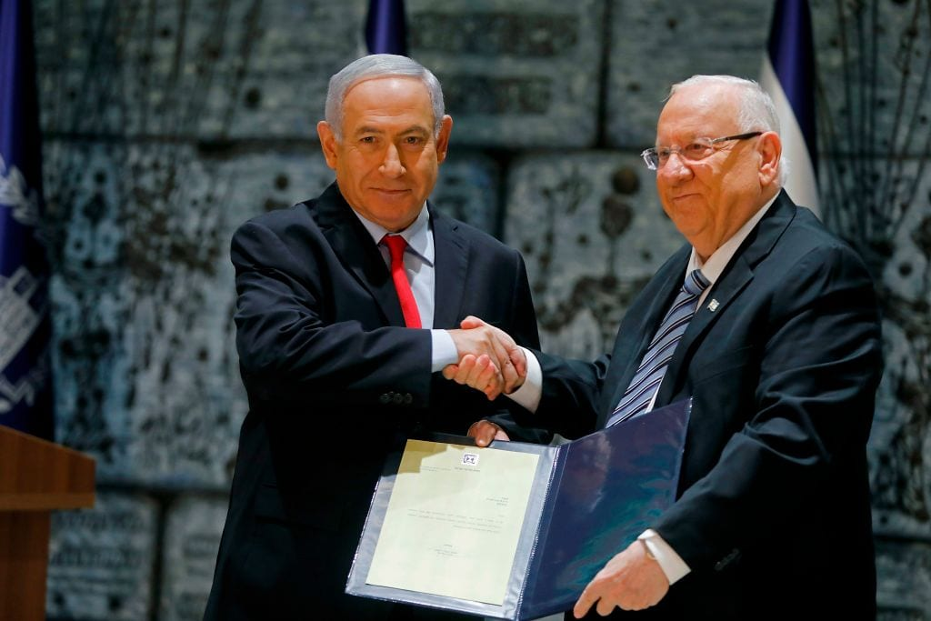Israeli Prime Minister Benjamin Netanyahu (L) shakes hands with President Reuven Rivlin at the latter's residence in Jerusalem on 17 April 2019. [MENAHEM KAHANA/AFP/Getty Images]