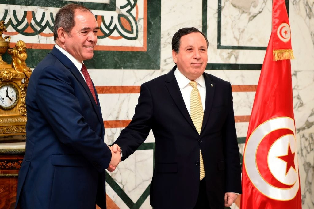 Tunisia's Foreign Minister Khemaies Jhinaoui (R) welcomes his Algerian counterpart Sabri Boukadoum in the capital Tunis on 26 April, 2019 [FETHI BELAID/AFP/Getty Images]