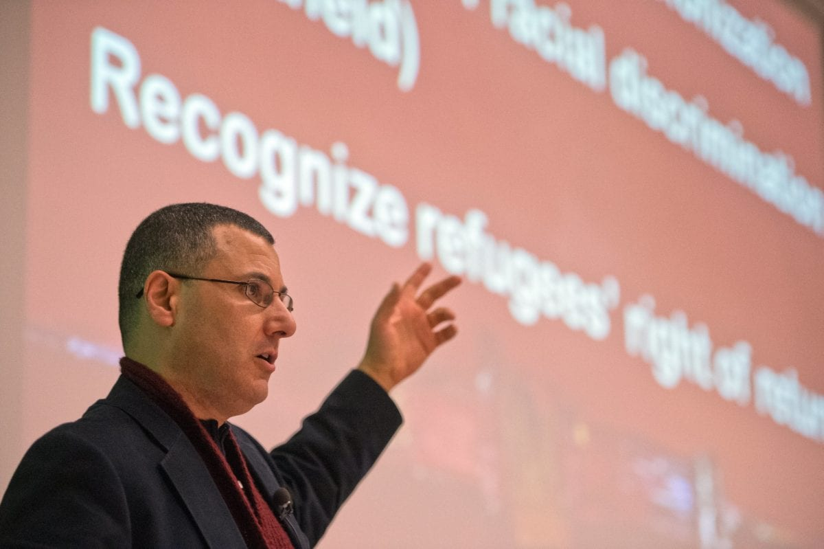 Palestinian researcher, commentator, and human rights activist Omar Barghouti speaks during a conferenceat the ULB university in Brussels, on 30 April 2013. [AFP PHOTO / BELGA - ERIC LALMAND / Getty]